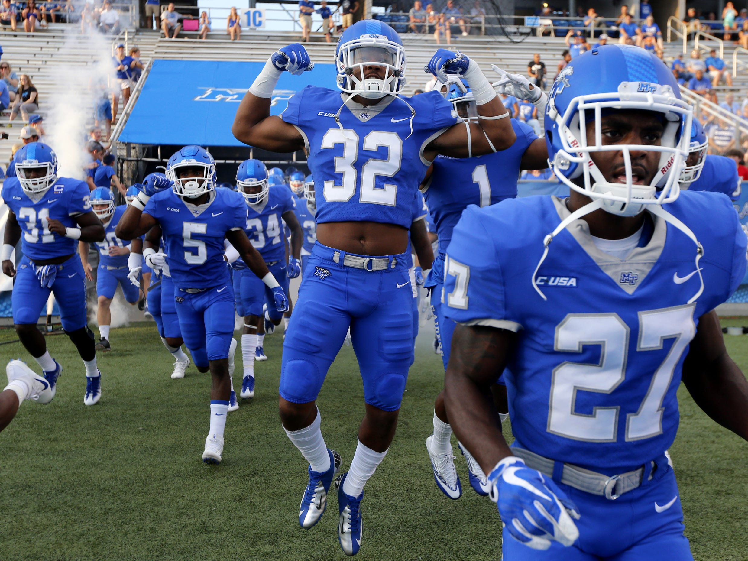 MTSU players including Chris Melton (32) come out of the tunnel as they take the field before the start of the football game against Bowling Green on Saturday, Sept. 23, 2017.