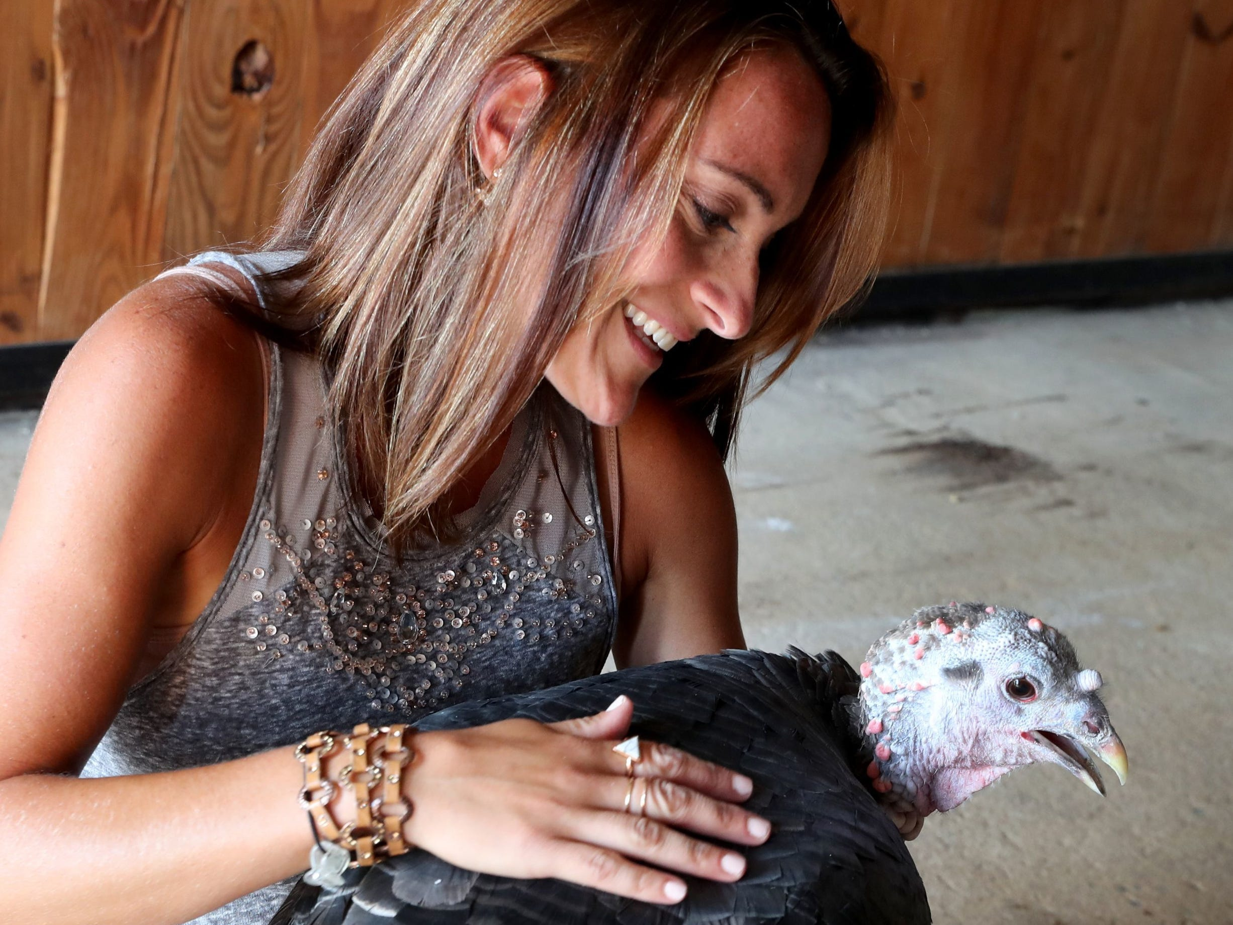 Donna Sabeno loves on one of the turkeys at the new Christiana location of The Gentle Barn on Aug. 12.Donna Sabeno loves on one of the turkeys at the new Christiana location of the The Gentle Barn a home, on Sunday, Aug. 12, 2018.