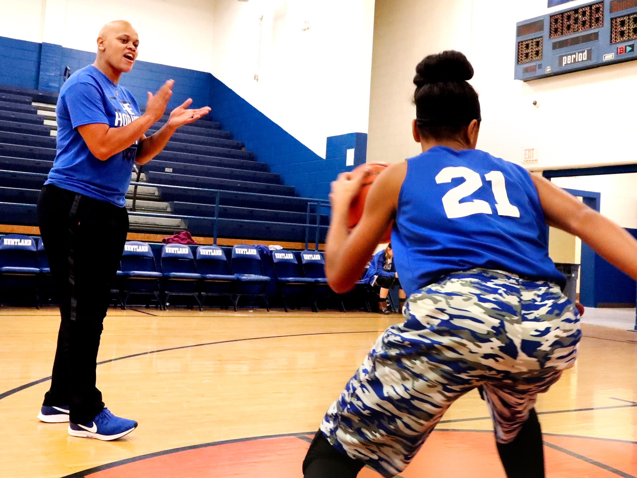 Coach Tia Stovall encourages and pushes her middle school players during practice, including her daughter TaTianna Stovall (21) on Tuesday, Nov. 13, 2018.