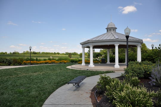 The gazebo at Gateway Island, overlooking an urban park off Medical Center Parkway, serves as a small wedding venue.