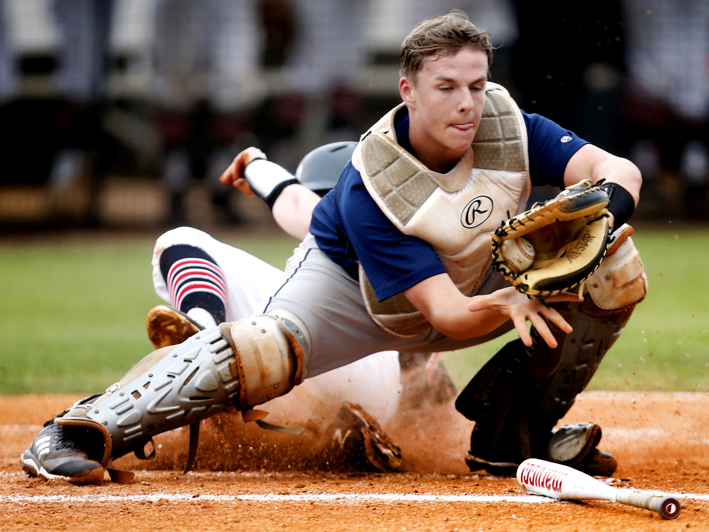 Stewarts Creek's Kaine Severance (27) slides into home to score as Siegel's catcher Jackson Cauthron (18) catches the ball during the Region 4-AAA baseball title game on Tuesday, May 15, 2018, at Stewarts Creek.