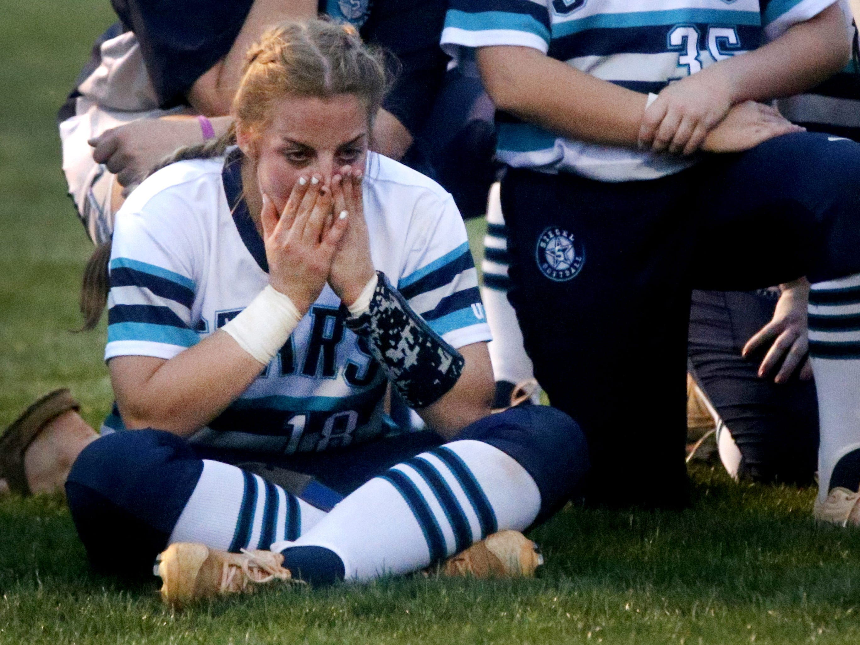 Siegel's Claire Czajkowski (18) reacts to losing to Lincoln County in the 4-AAA softball semifinal on Monday, May 14, 2018, at Siegel.