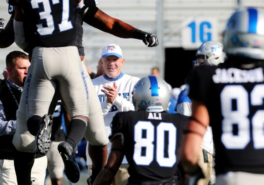MTSU head coach Rick Stockstill huddles with his team before the game against UAB at MTSU on Saturday, Nov. 24, 2018.