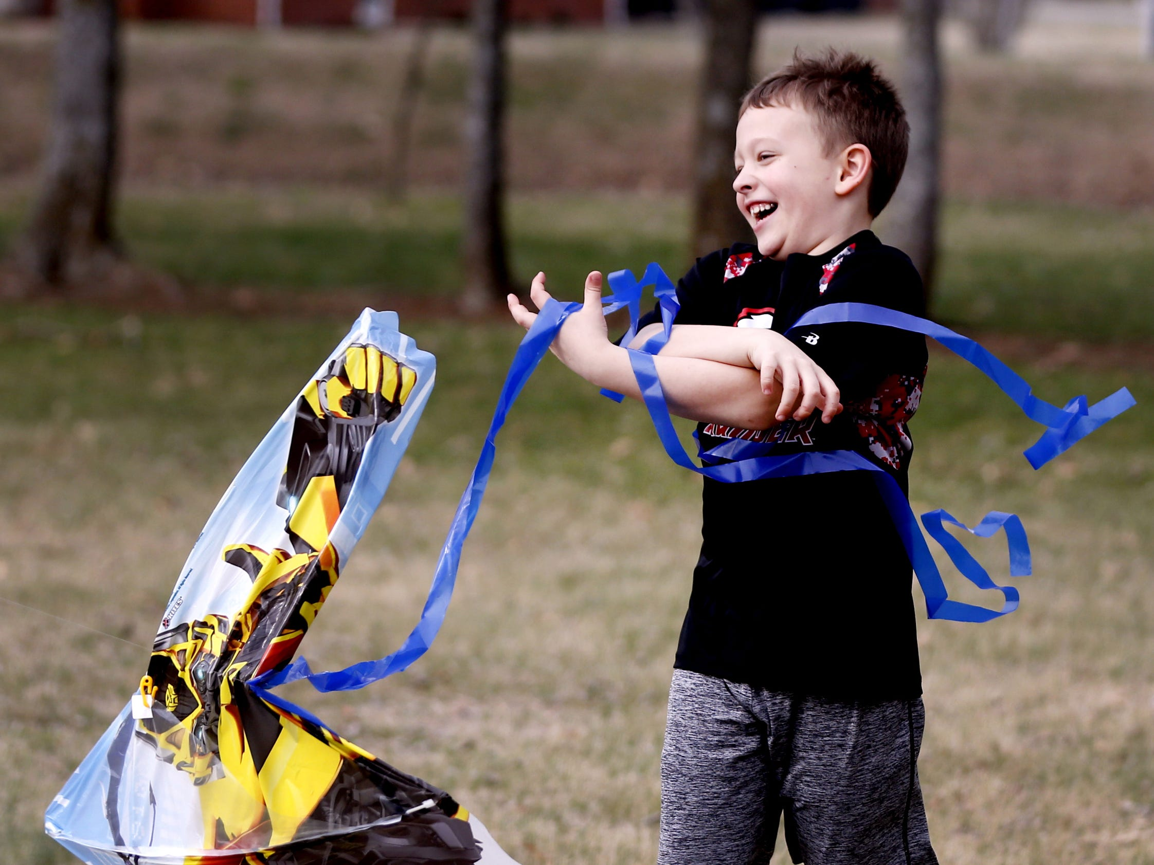 Declan Rockwood, 6 tires to get his kite to take flight on the breezy and warmer than normal day at Barfield Crescent Park, in Murfreesboro, on Monday, Feb. 19, 2018.