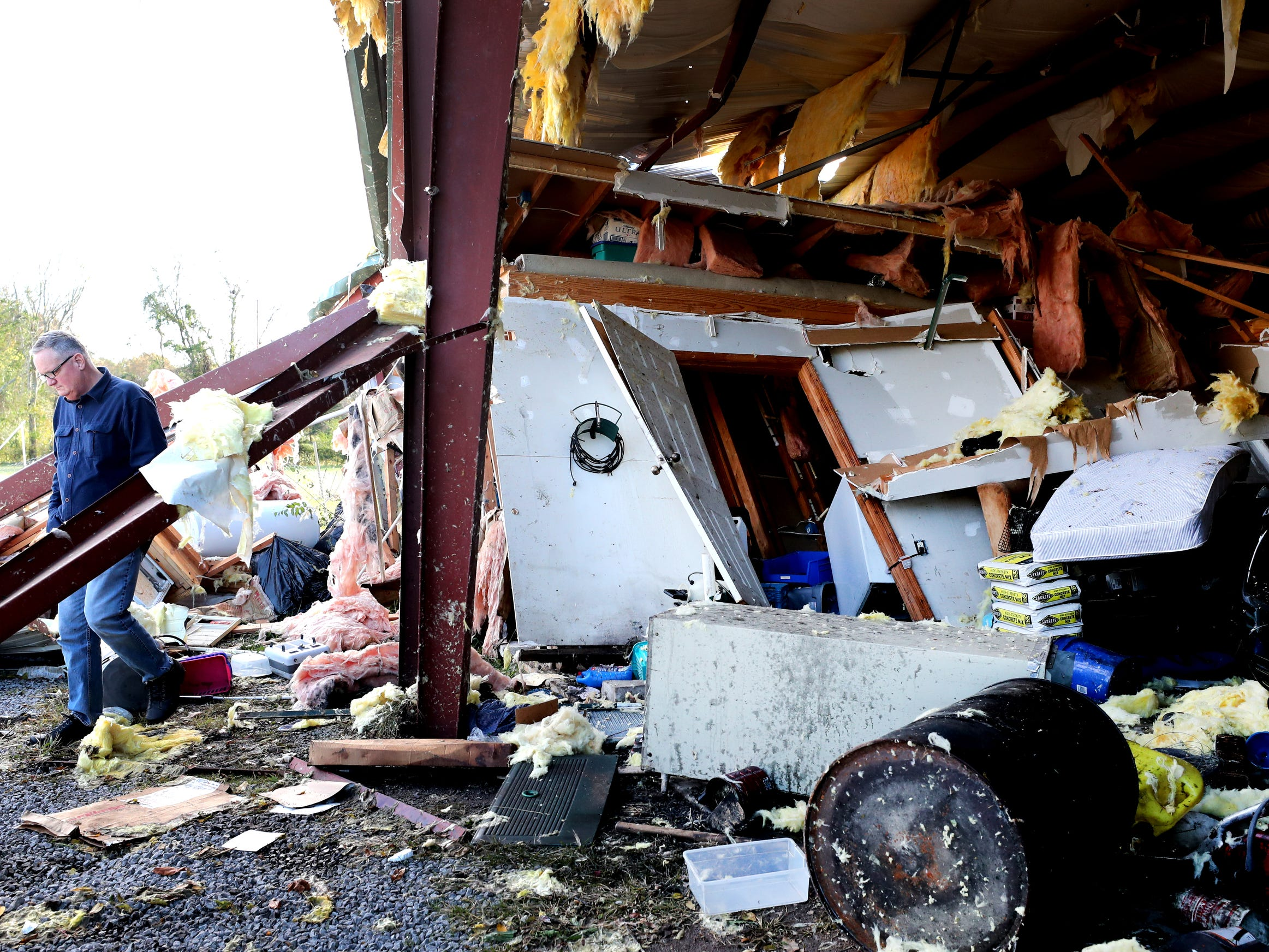 Billy Grimes Jr. shows off tornado damage to a work shed owned by friends Hank and Ava Jordan at the Jordan home along Rock Springs Midland Road in Christiana, Tenn. on Tuesday, Nov. 6, 2018.