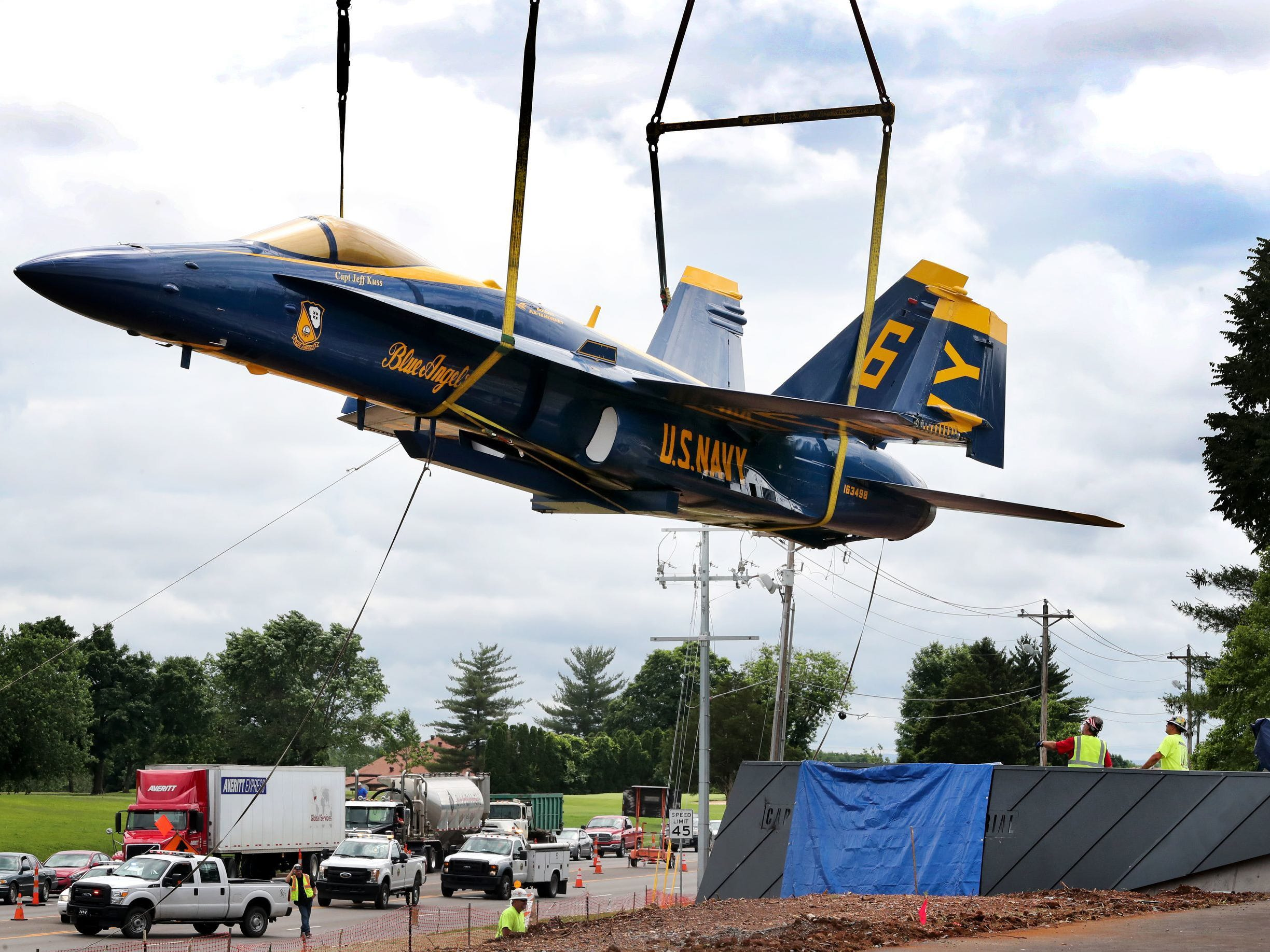 A Blue Angel F/A-18C Hornet was hoisted in the air and placed on a pedestal as it was installed at the memorial for Blue Angels pilot Capt. Jeff Kuss in Lee Victory Recreation Park, on Friday, June, 1 2018.
