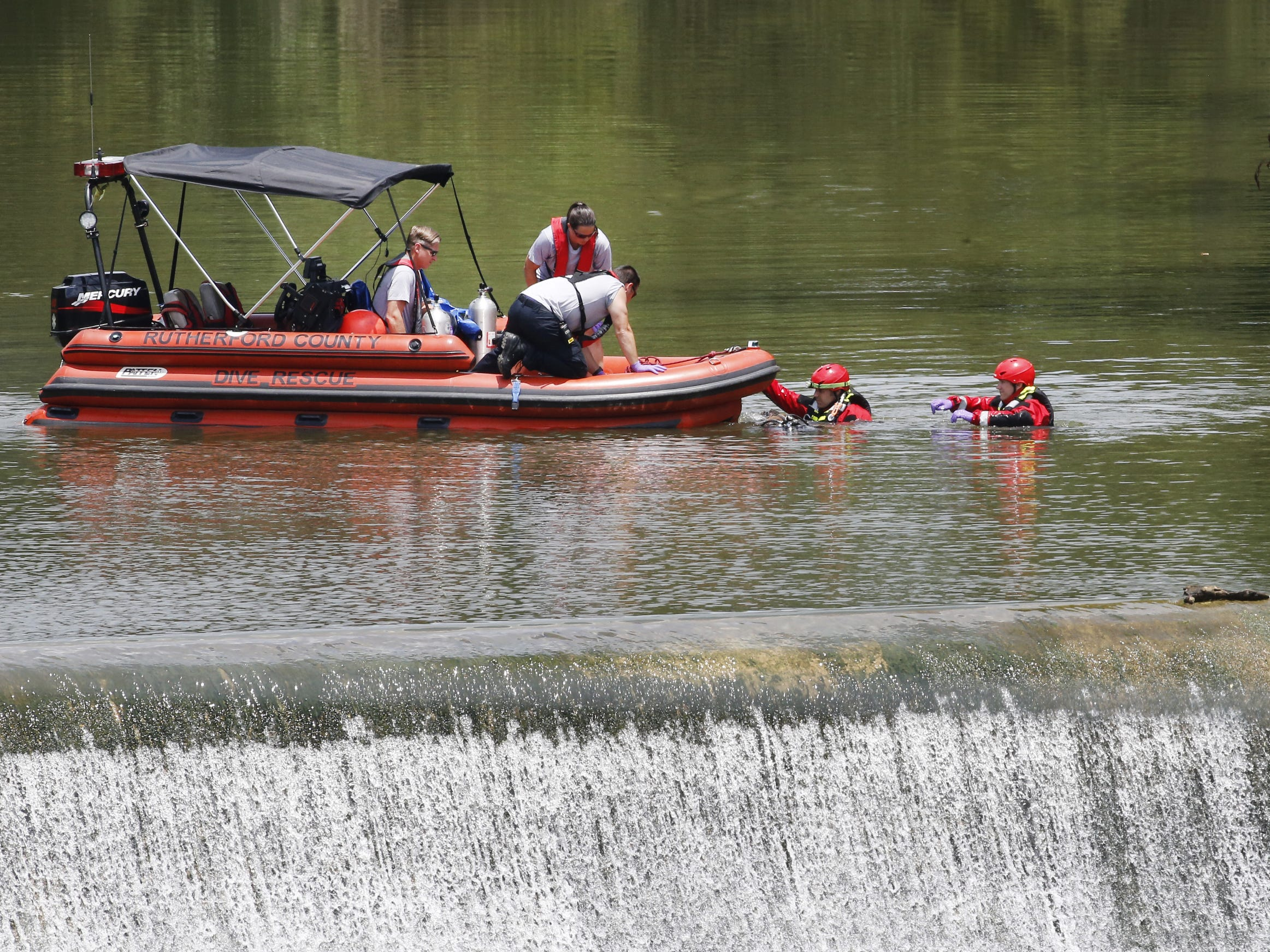 Rescue workers prepare the boat as they retrieve the body of Floyd Walter Corley Jr. from the Stones River at the Water Hill Dam on Monday, July 2, 2018.