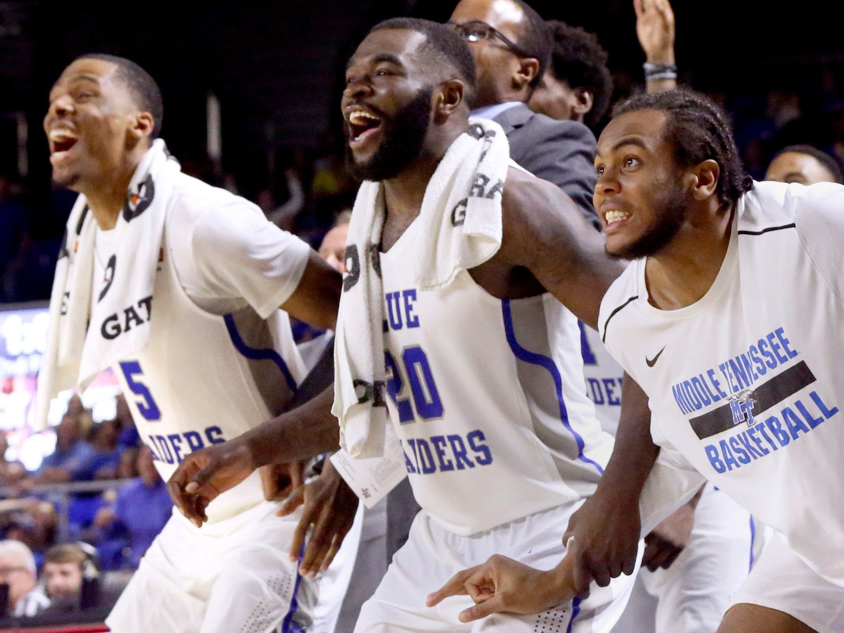 MTSU?s Nick King (5), Giddy Potts (20) and TJ Massenburg (15) react from the bench in the final minutes of the game against UAB on Saturday. HELEN COMER / DNJ