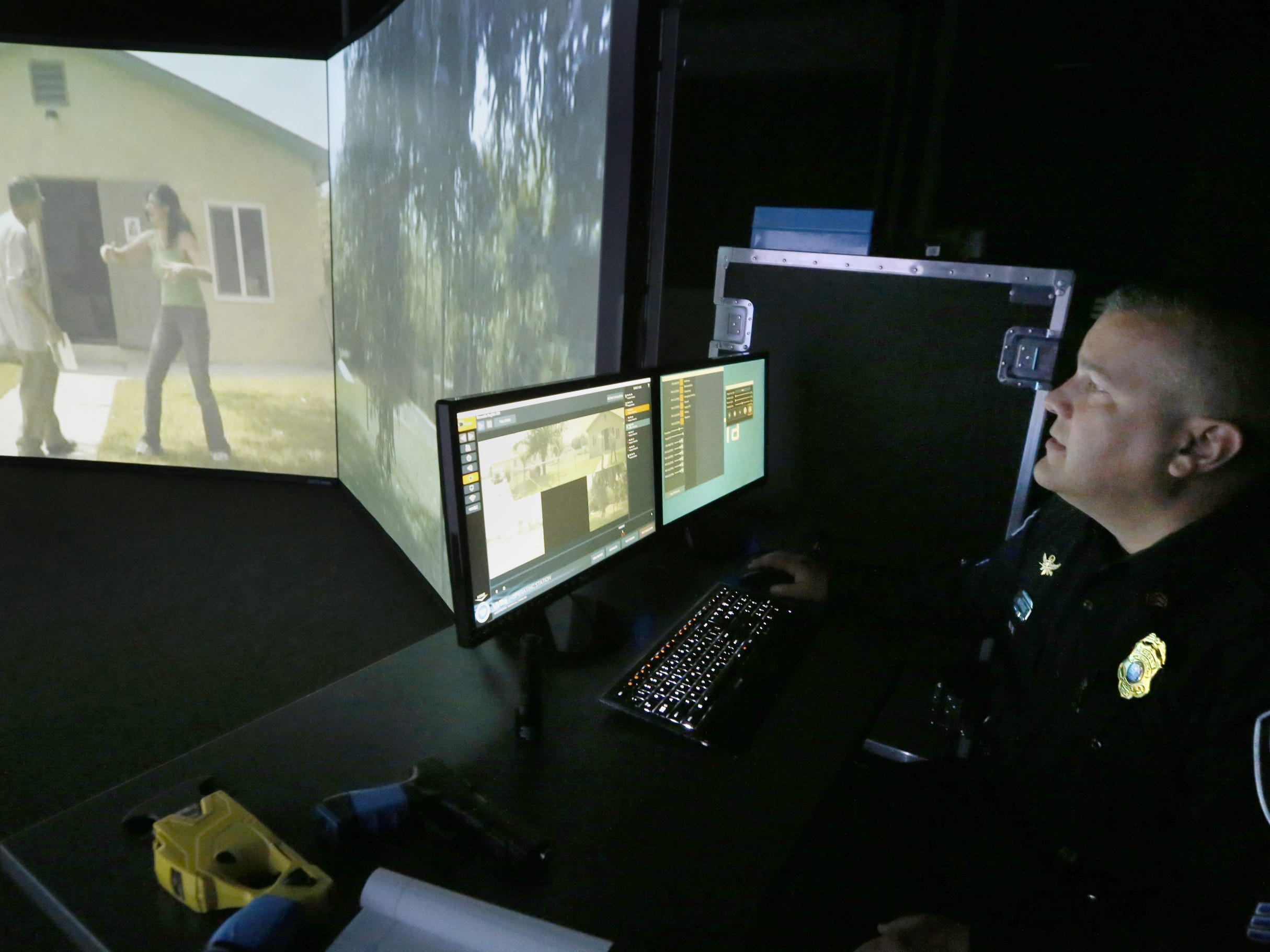 Sgt. Scott Newborn with the Murfreesboro Police Department shows off the firearms simulator in the new Murfreesboro Police Headquarters during a tour of the building, on Monday, May 7, 2018.