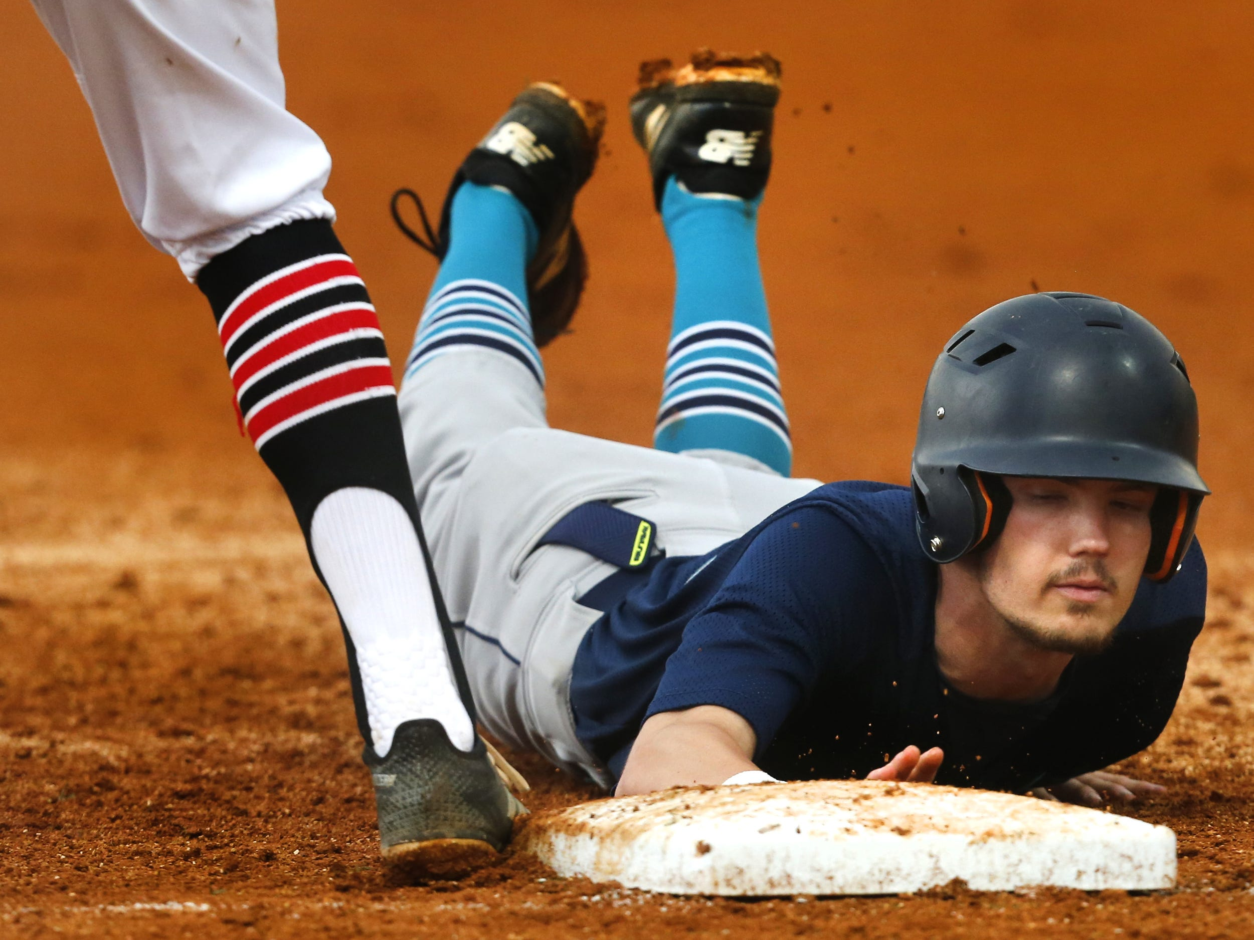 Siegel's Zach Bondurant (26) dives back to first base during the game against Stewarts Creek in the Region 4-AAA baseball title game on Tuesday, May 15, 2018, at Stewarts Creek.