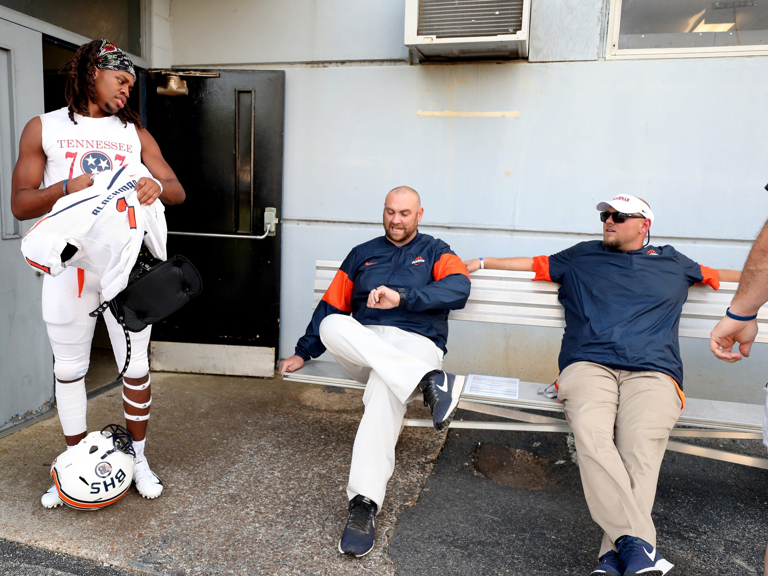 Blackman High School football player Adonis Otey talks with some of the coaches as he gets ready to take the field to warm up after arriving to Braly Municipal Stadium for the away game against Florence High School, on Friday Aug. 24, 2018, in Florence, Alabama.