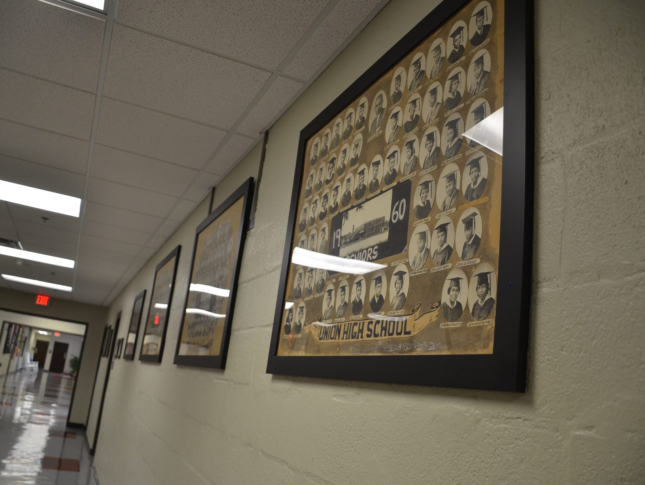 Various photos of senior classes from Union High School are displayed at the old high school, now used by nonprofits in Gallatin.