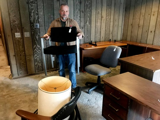Shopper Brian Racine looks for used furniture at Treasure Hunters Thrift Store in Goodlettsville.