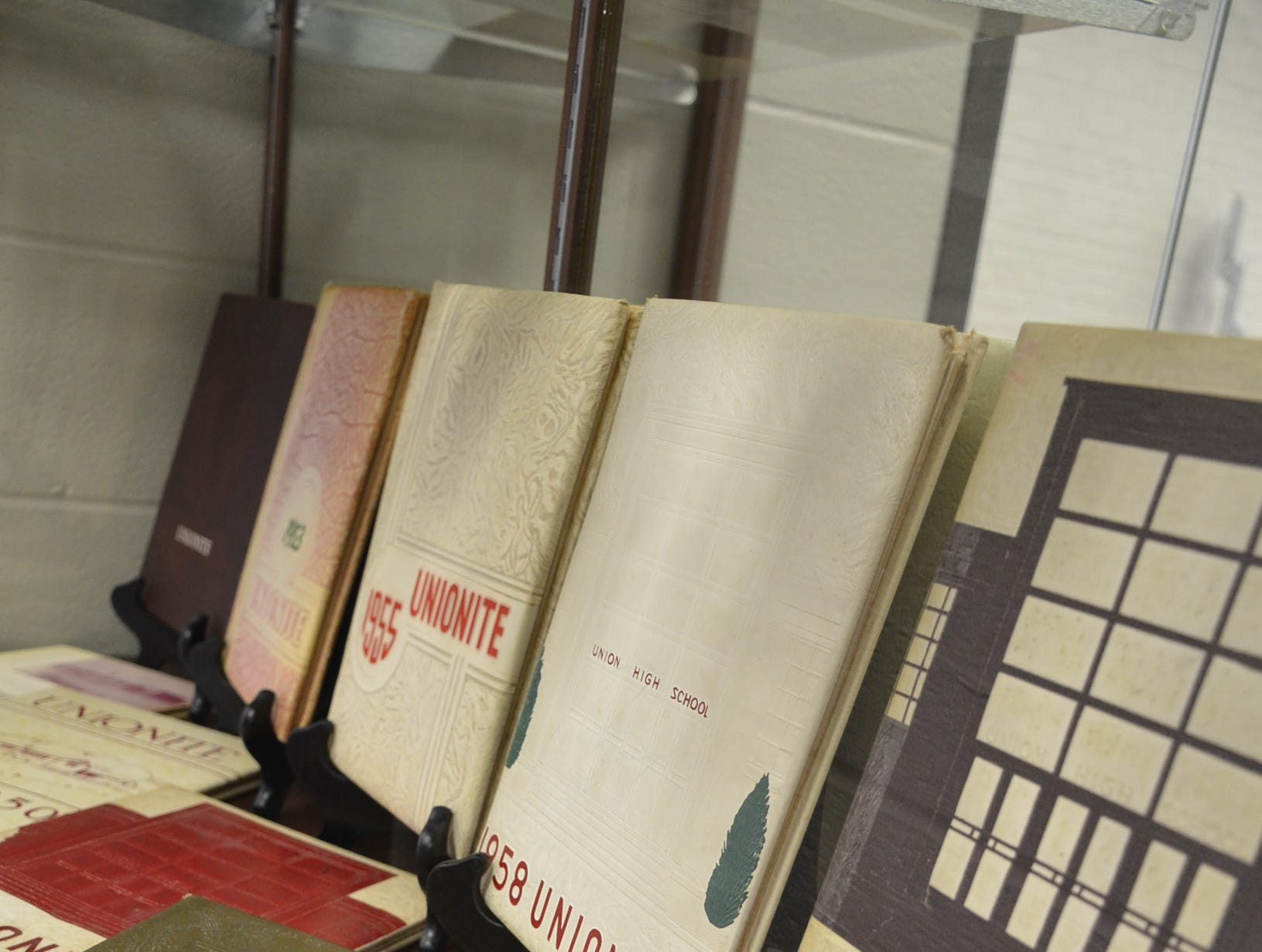 The Unionite books from the 1950s and 1960s are on display at the old Union High School in Gallatin.