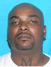 Jamal Jamel Gardner, 47, in a driver's license photo. Gardner has been charged in connection with the Saturday shooting at a police officer in Columbia. He is believed to be armed and dangerous.