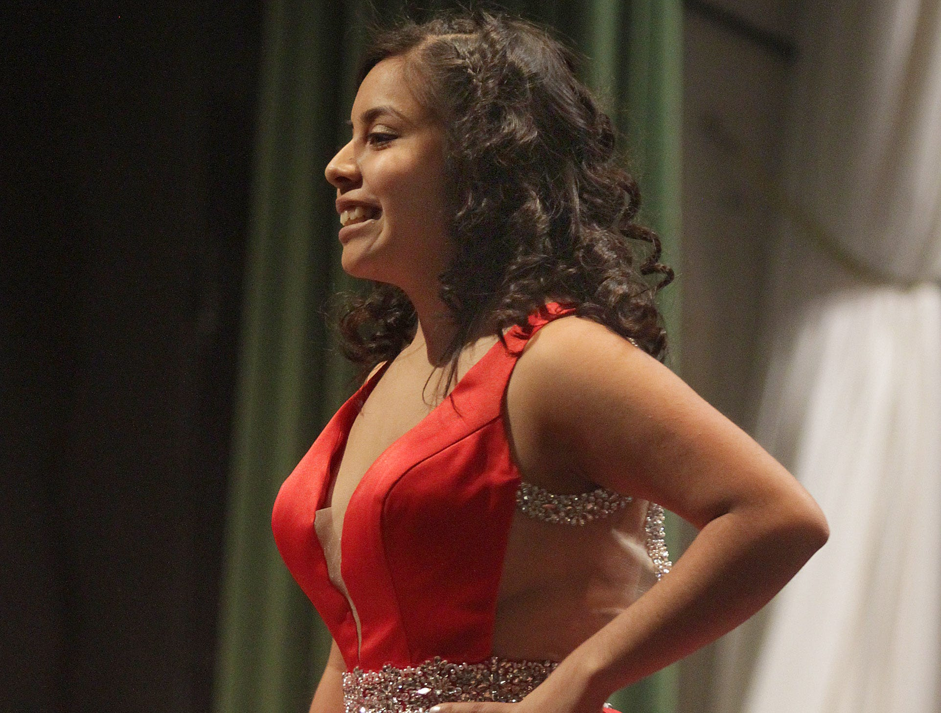 Rosa Gonzalez smiles on stage at Gallatin High's Annual Prom Show on Saturday, February 2, 2019.