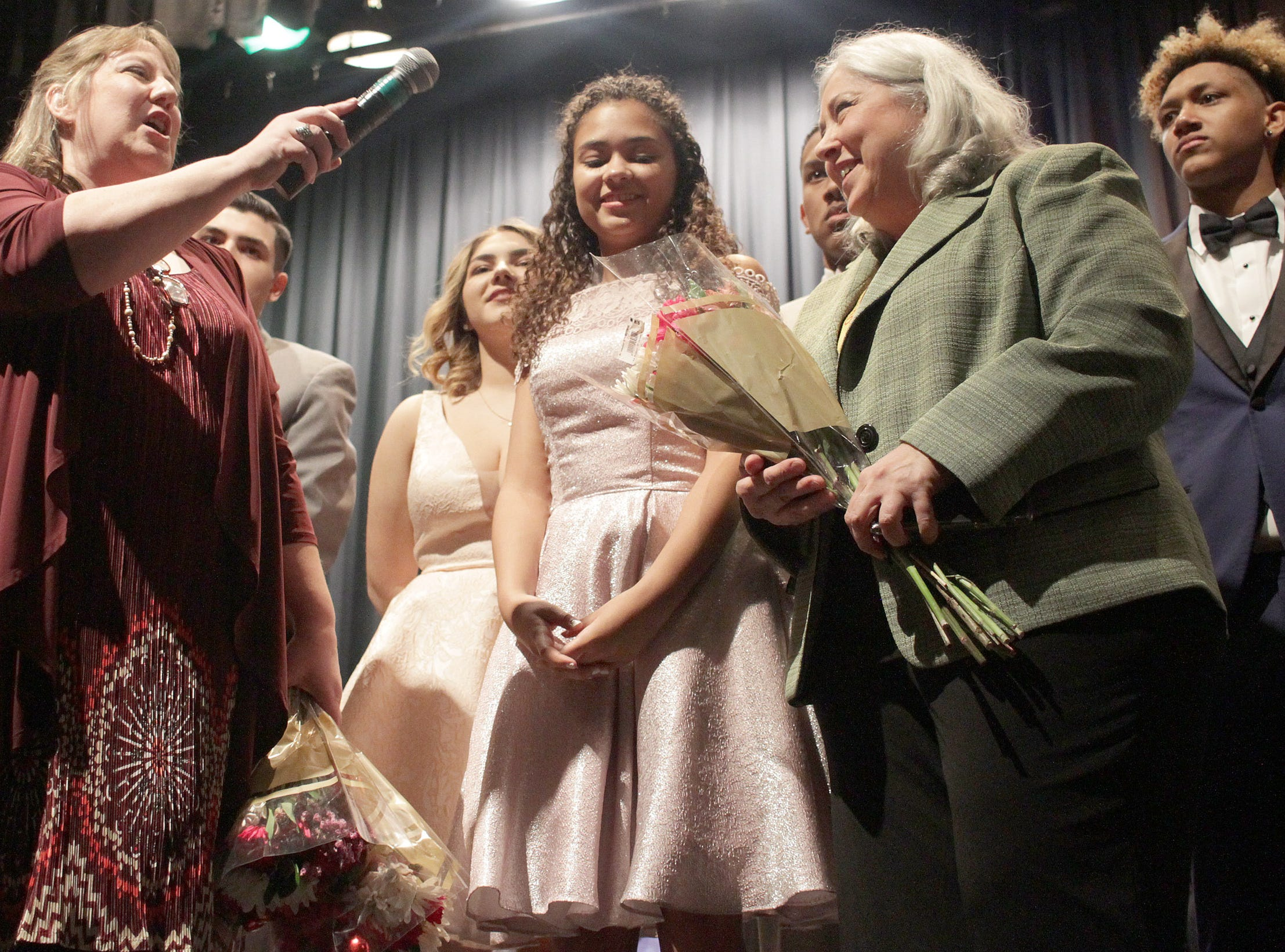 Roses are passed out at the end of Gallatin High's Annual Prom Show on Saturday, February 2, 2019.