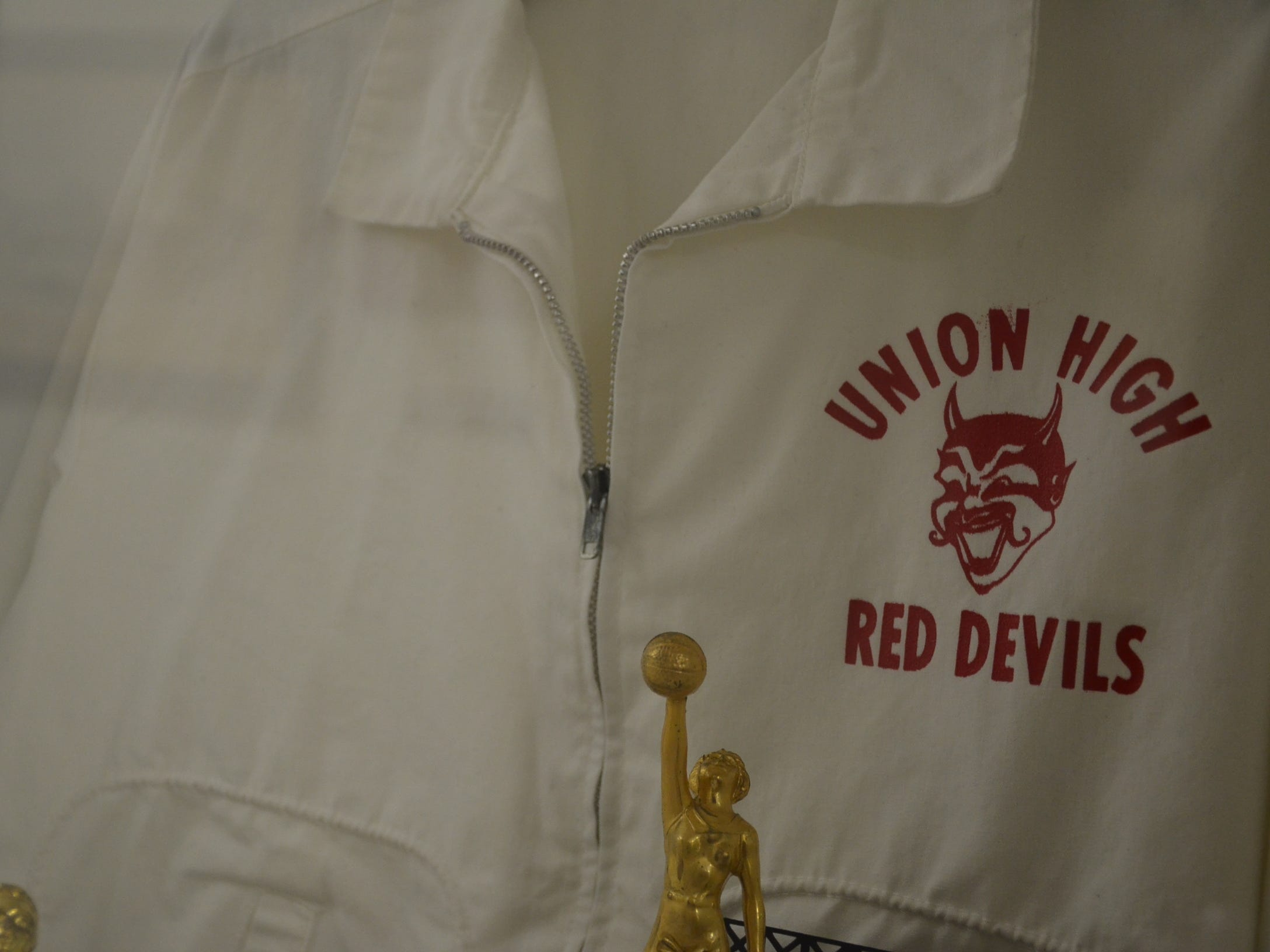 An old shirt with the Union High School Red Devils logo is on display at the school, which is now home to Gallatin Shalom Zone and other nonprofits.