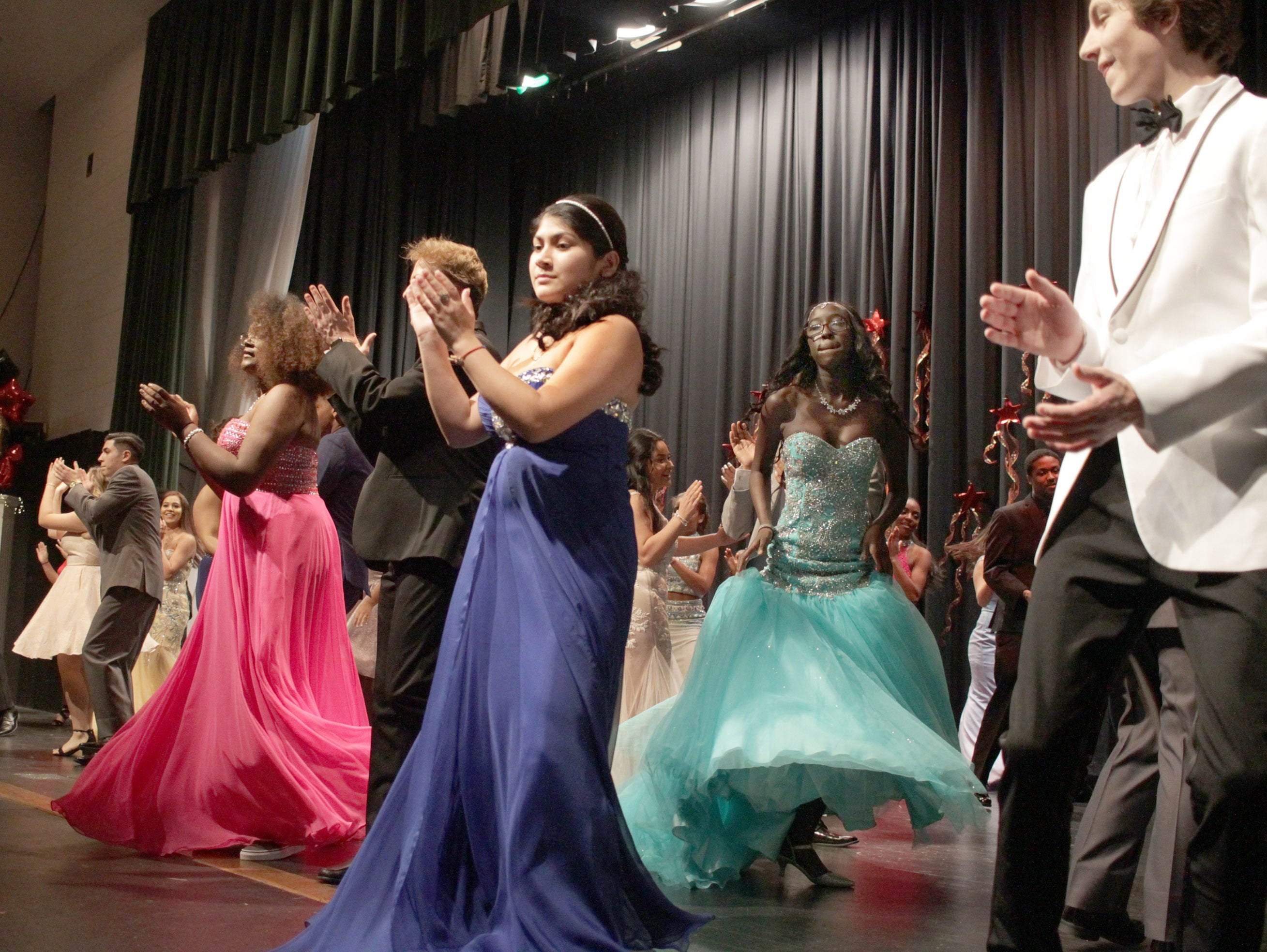 Performers applause in the finale of Gallatin High's Annual Prom Show on Saturday, February 2, 2019.