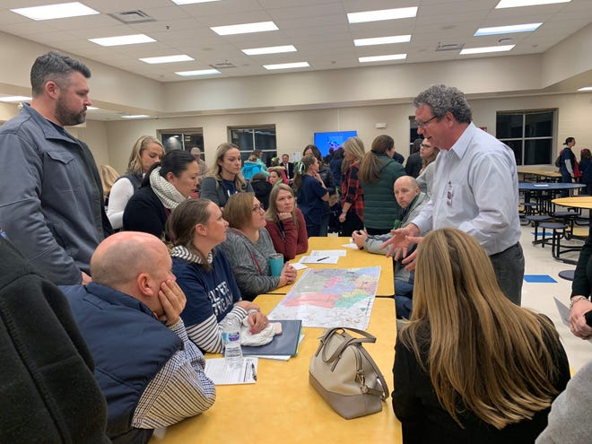 Williamson County School Board member Eliot Mitchell speaks with parents at a public meeting on proposed rezonings.