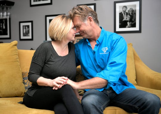 """John Schneider with his girlfriend, Alicia Allain, in their Music Row home in Nashville on Feb. 1. """"Alicia believes in me more than I believe in me,"""" Schneider says."""