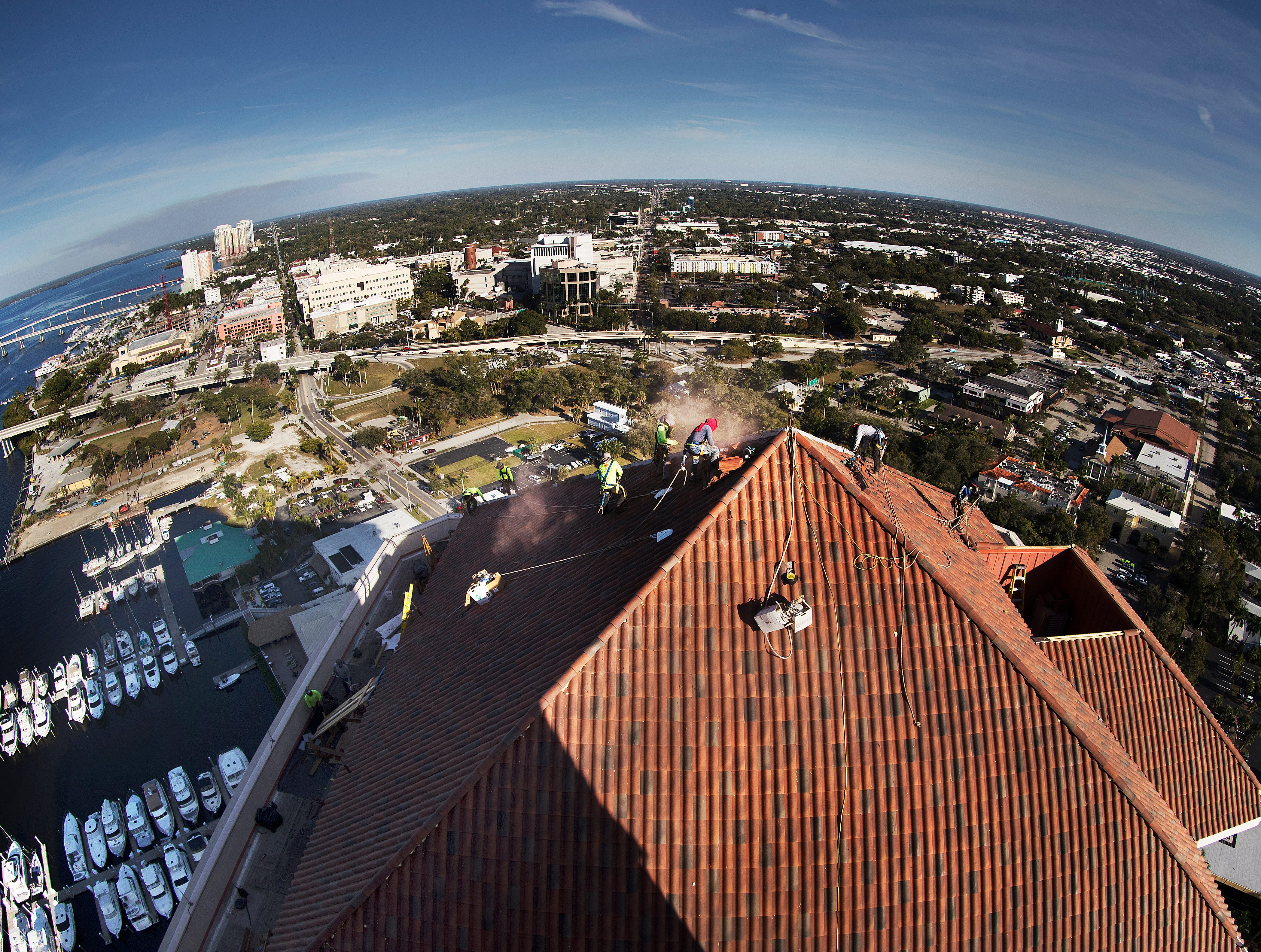 The roof of High Point Place in downtown Fort Myers is being replaced after it was damaged by Hurricane Irma in 2017. The tallest of five buildings stand at 32 stories high and are the highwar buildings between Miami and Tampa. The roof on all the buildings are being replaced by Crowther Roofing.