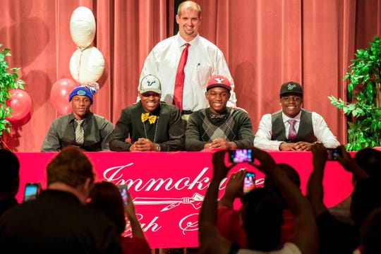 J.C. Jackson (far left), now a cornerback with the New England Patriots, poses during National Signing Day 2014, when he was a senior at Immokalee High School and committed to the University of Florida. Behind him is Rich Dombroski, the Immokalee coach during the 2013 season. Also with him are (left to right), Jimmy Bayes, Johnson Louigene and D'Ernest Johnson.