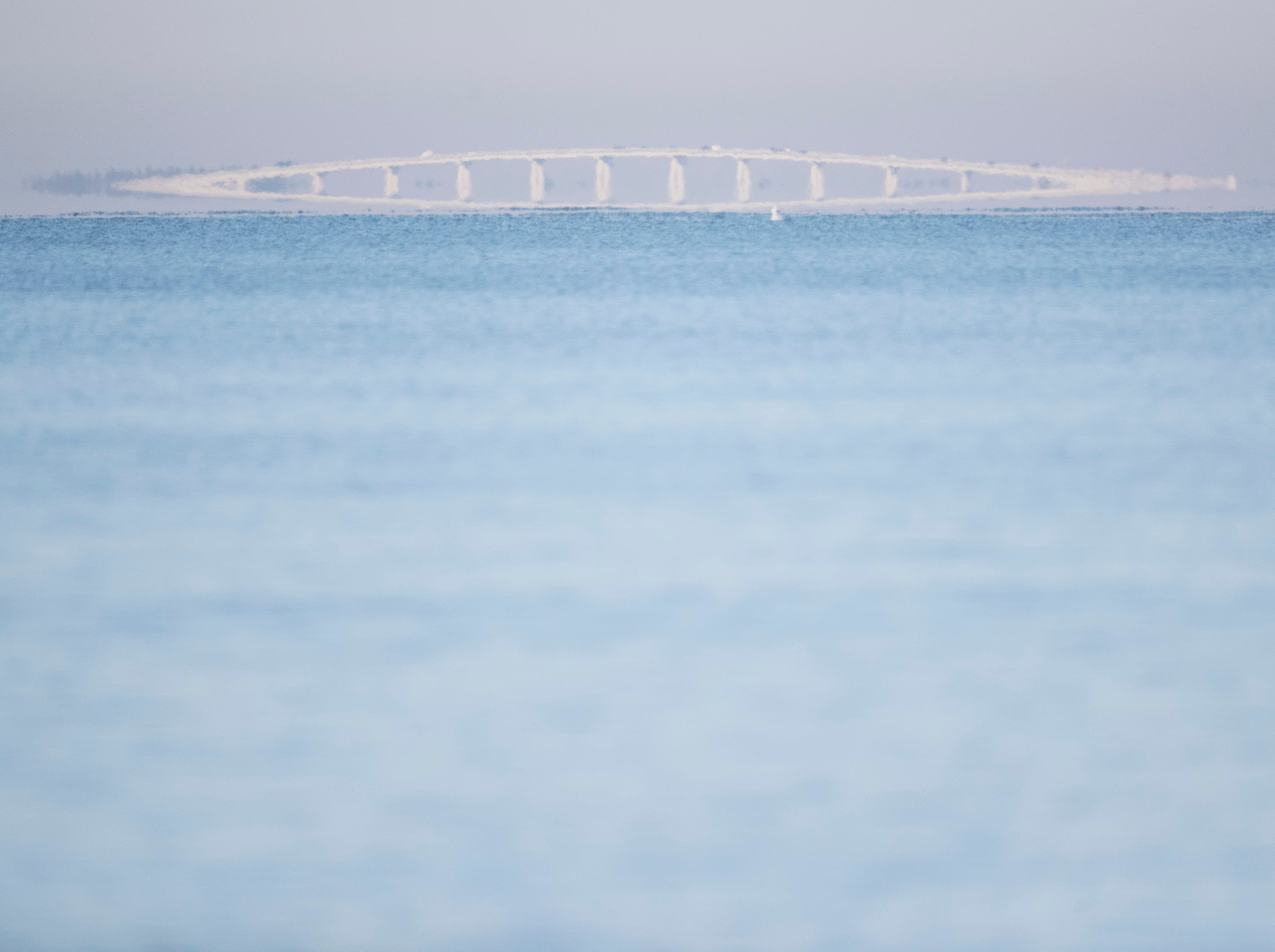 The Sanibel Causeway is seen shrouded in fog as photographed from the south end of Fort Myers Beach on Tuesday 1/29/2019. Southwest Florida is still seeing patchy reports of red tide, mostly in the northern region like northern Lee County and Charlotte County. The numbers are way down or non existent in this area.