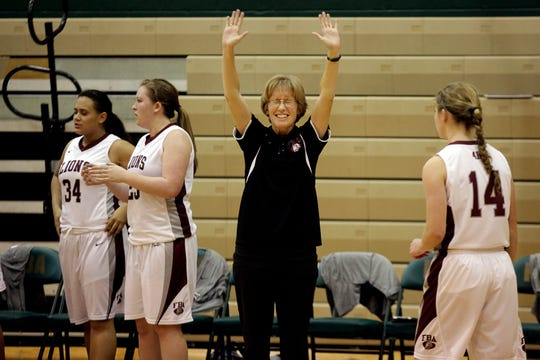 Jen Lines, shown celebrating a win in 2013, is resigning as First Baptist Academy's girls basketball coach at the end of the 2018-19 season. Lines has coached the program since it became a varsity team in 2009.