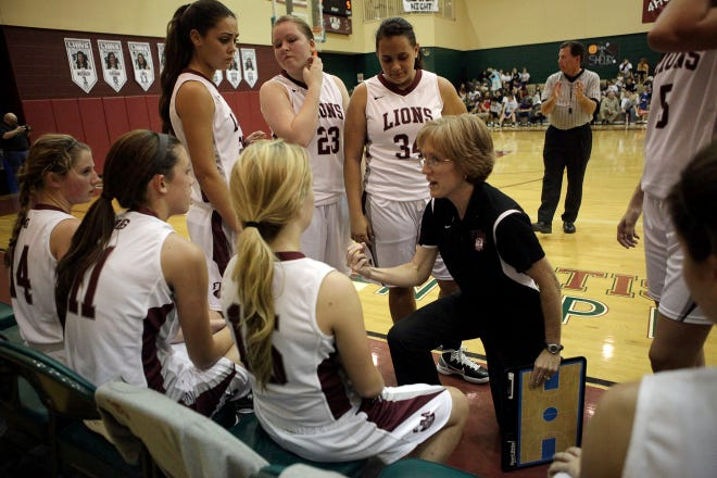 First Baptist Academy varsity girls basketball coach Jennifer Lines, shown during a 2013 game, is resigning at the end of the season. She has coached FBA all 10 season since it became a varsity program in 2009.