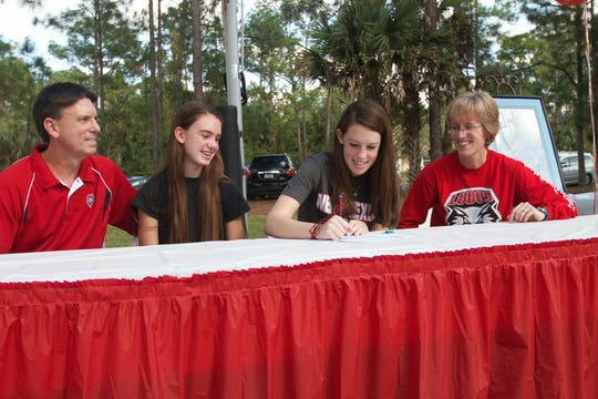 Emily Lines signs her letter of intent to play basketball at the University of New Mexico in 2014.  Basketball is big in the Lines family. Rick Lines (far left) has been a local referee for 23 years. Amanda Lines (second from left) played five years a First Baptist Academy for her mother Jen Lines (right). Emily played for six years at FBA, all for her mother.