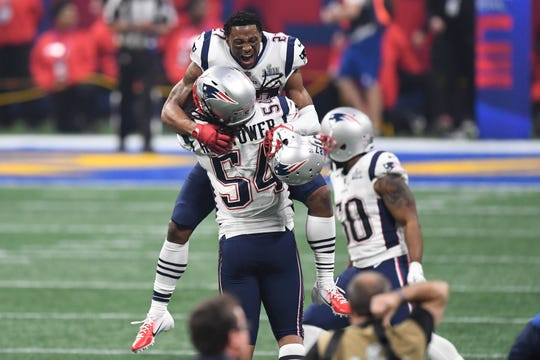 New England Patriots defensive back J.C. Jackson (27) of Immokalee and outside linebacker Dont'a Hightower (54) celebrate after Super Bowl LIII against the Los Angeles Rams at Mercedes-Benz Stadium on Sunday, Feb. 3 in Atlanta.