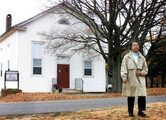 -  -Elaine Edwards, Mt. Zion AME Church historian, outside the church in Woolwich Township. Elaine is trying to get the church listed on the state and national historic registries. Photo by Ron Karafin