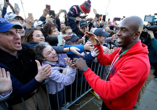 New England Patriots free safety Devin McCourty, right, greets fans following the football teams arrival at Gillette Stadium, Monday, Feb. 4, 2019, in Foxborough, Mass, after defeating the Los Angeles Rams Sunday in Atlanta, Ga.