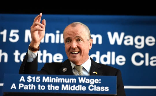 Gov. Phil Murphy signed a bill raising New Jersey's minimum wage to $15 an hour during a ceremony at headquarters of immigrant advocacy group Make The Road NJ in Elizabeth on Monday, February 4, 2019. The minimum wage will raise incrementally to $15 an hour in 2024.