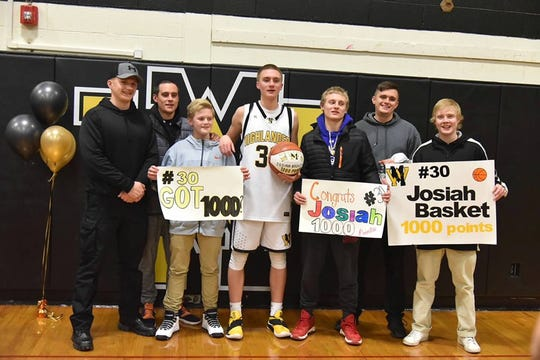Josiah Basket with his six brothers after scoring his 1,000th career point.
