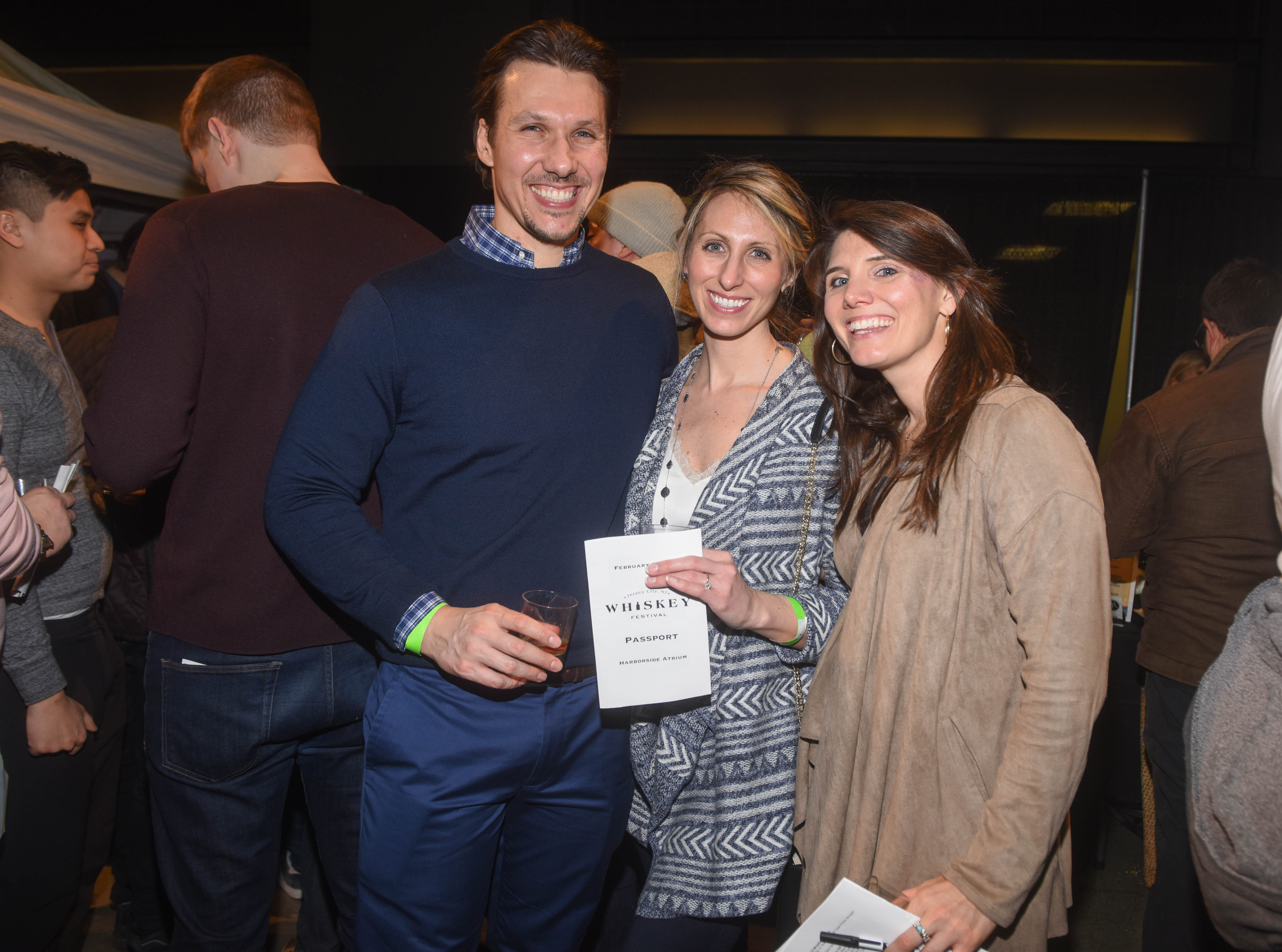 Jason Orr, Cassandra Svenson and Emily Landgraf. Jersey City Whiskey Fest was held at Harborside Atrium. The event featured over 100 styles of whiskey and spirits. 02/01/2019