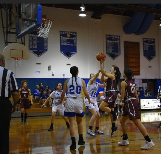 Leonia senior Leonora Lita goes up for a shot in a girls basketball game at Wallington on Sunday. The Lions prevailed for their seventh win of the year, equaling their total from the past two seasons combined.