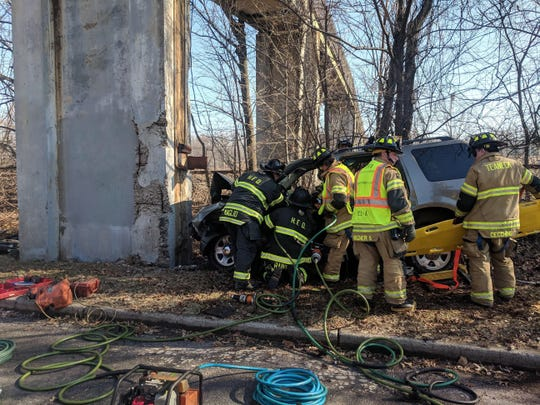 A woman was trapped in her car after slamming into a concrete footbridge in Teaneck.