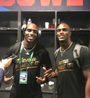 Devin and Jason McCourty celebrate in the locker room following the Patriots' 13-3 victory over the Rams in Super Bowl LIII. They became the first twins to win the Vince Lombardi Trophy as teammates Sunday night.