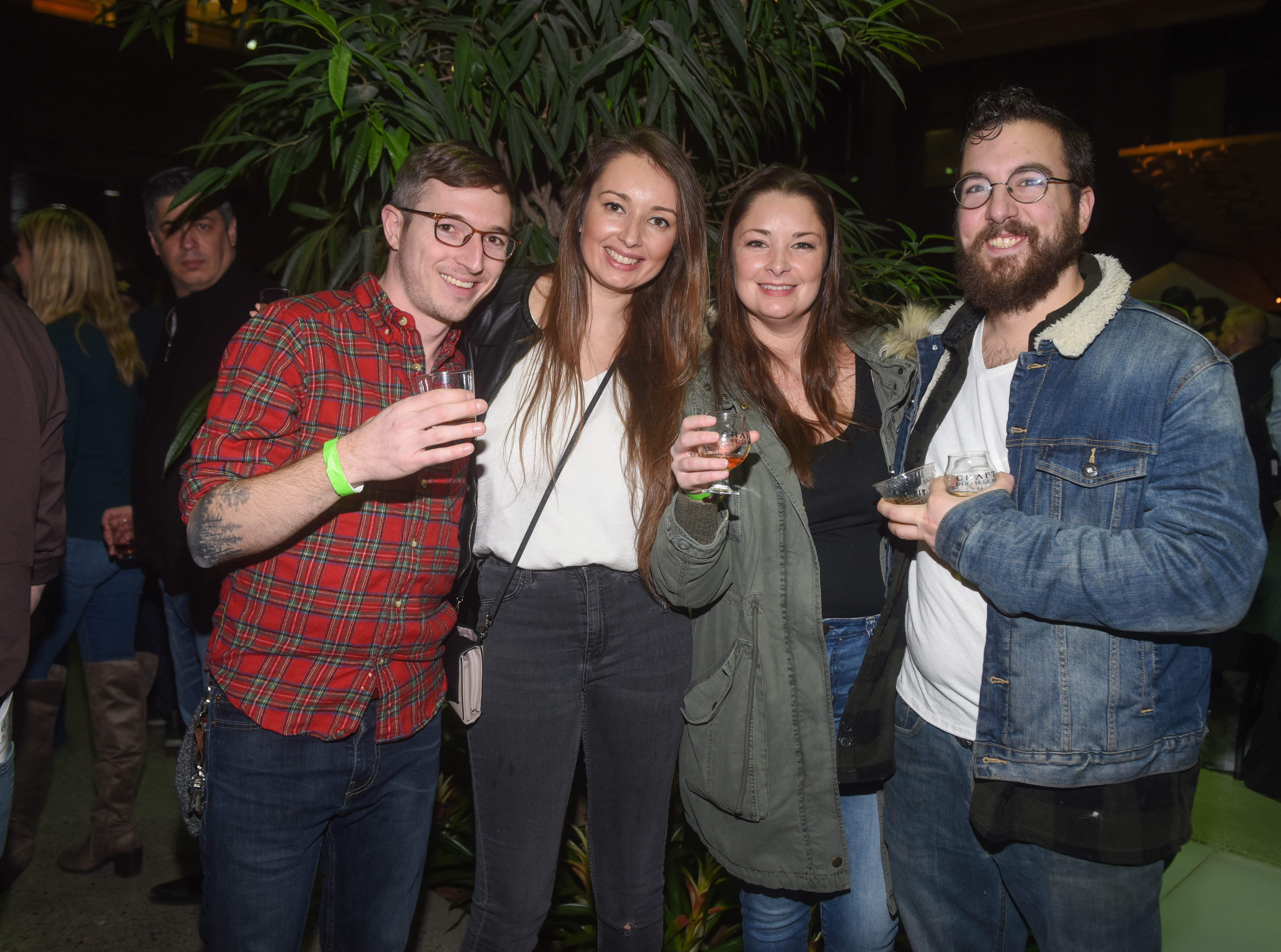 Eric, Sam, Lisa and Alex. Jersey City Whiskey Fest was held at Harborside Atrium. The event featured over 100 styles of whiskey and spirits. 02/01/2019