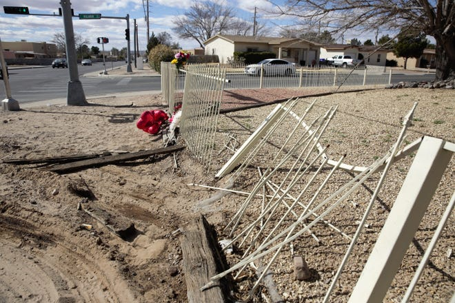 A fence sits askew on Monday, Feb. 4, 2019 at the corner of Kilmer Street and Spruce Avenue in Las Cruces. A fatal crash happened here early Saturday, Feb. 2.
