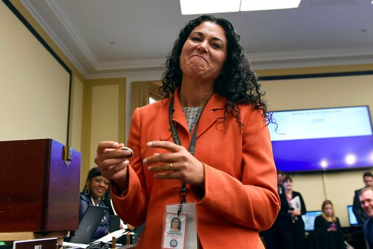 In this Nov. 30, 2018, file photo, Rep.-elect Xochitl Torres Small, D-N.M., reacts after drawing her number during the member-elect room lottery draw on Capitol Hill in Washington. Torres Small told The Associated Press she doesn't mind not getting as much attention as other freshmen in Congress because she has other goals around border security.