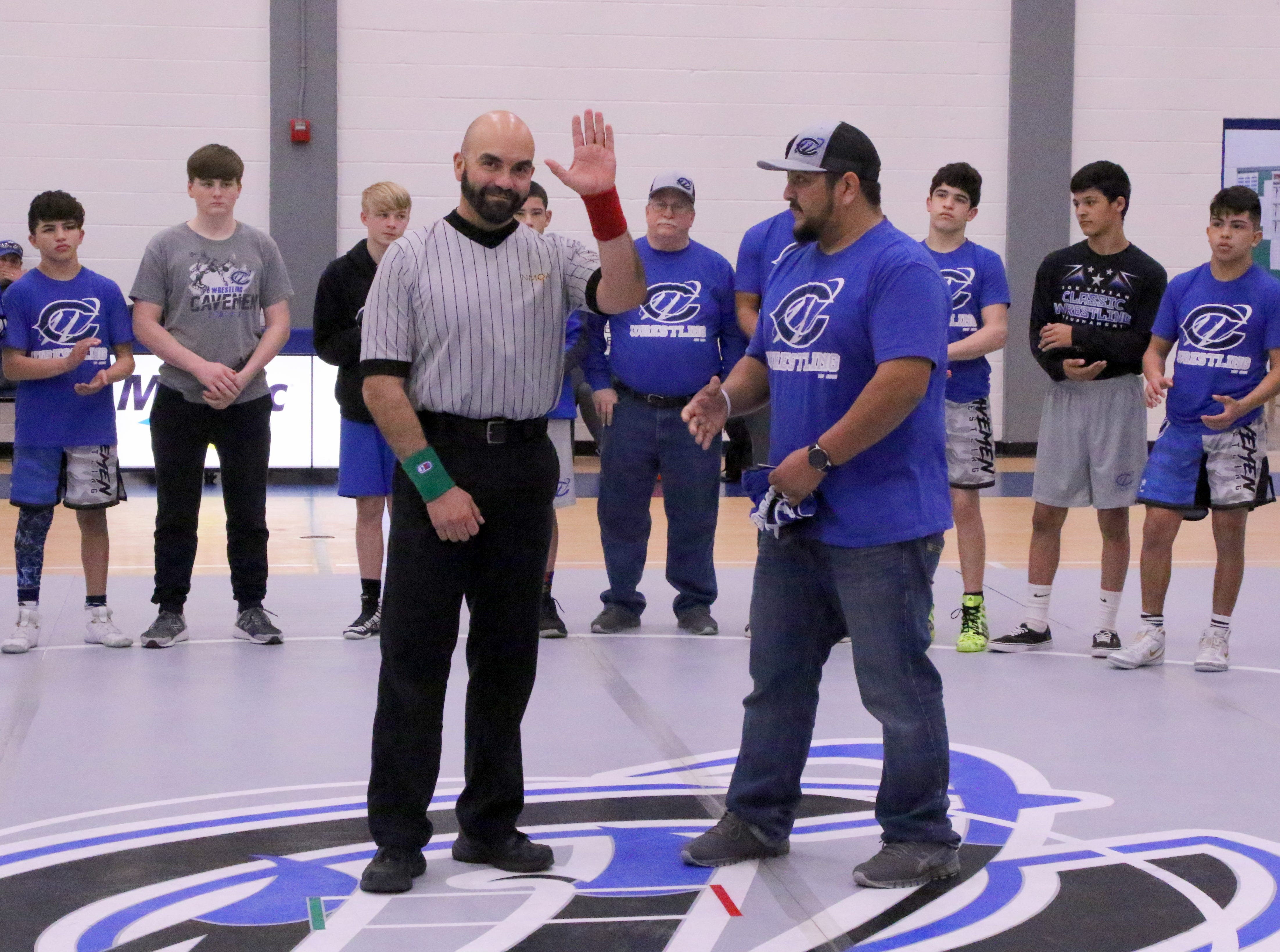 As part of Referee Appreciation Week, Carlsbad honors its referee before during Saturday's District Dual in Carlsbad.
