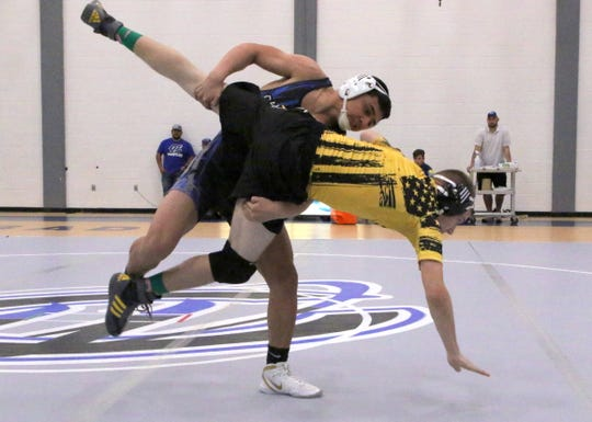 Ivan Villareal takes down his opponent during Saturday's District Dual in Carlsbad. Villareal won by pinfall.