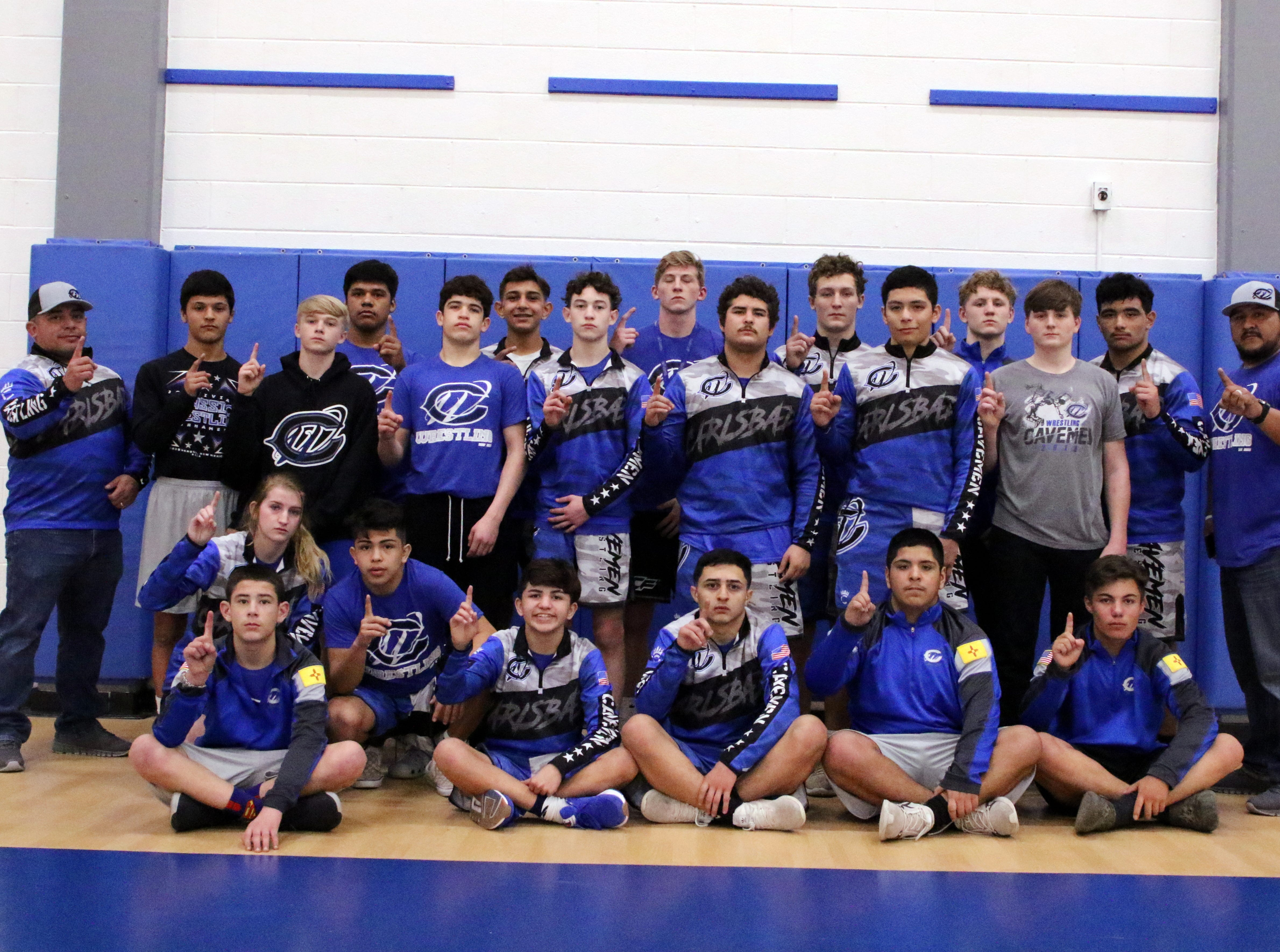 The Cavemen wrestling team poses after Saturday's District Dual in Carlsbad against Alamogordo. The Cavemen won, 84-0 to claim the district title for the second consecutive season.