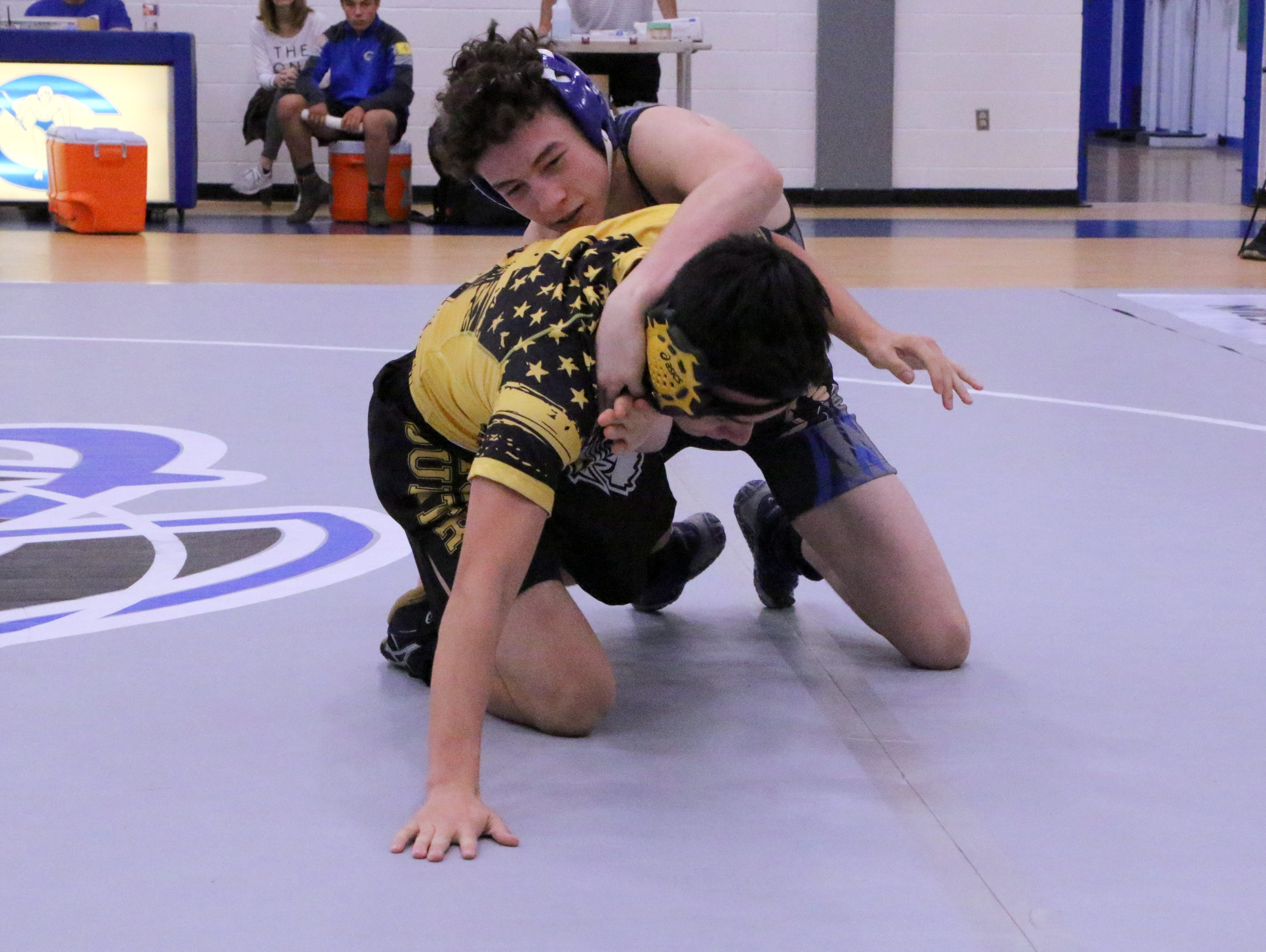 Carlsbad's Logan Romero goes for a takedown of his Alamogordo opponent during Saturday's District Dual in Carlsbad. Romero won via pinfall.