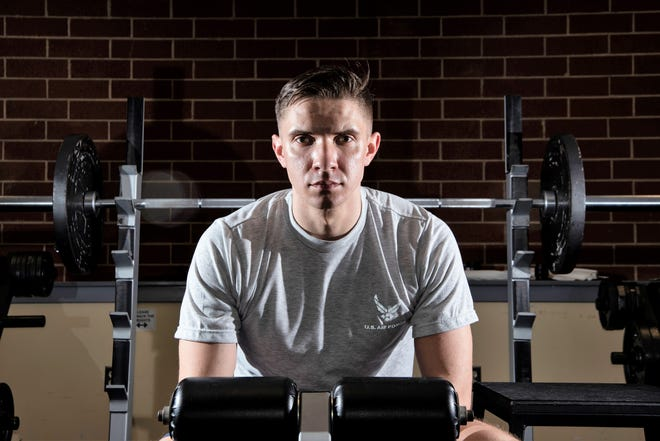 2nd Lt. Josh Thompson, 49th Wing Public Affairs officer, poses for a portrait, Jan. 25, 2019, at the fitness center on Fort George G. Meade, Md. After actively pursuing an Air Force commission for eight years, Thompson continues to challenge his physical limitations as a daily practice of resiliency.