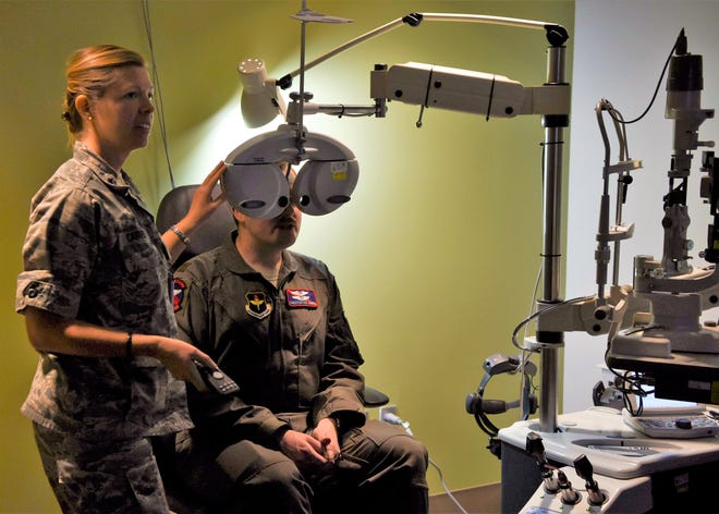 Lt. Col. Jennifer Carver, 49th Medical Group optometrist, conducts a vision exam for Maj. Christopher Vance, 9th Attack Squadron instructor pilot, Jan. 23, 2019, on Holloman Air Force Base, N.M. The 49th MDG Optometry Clinic's primary mission is to perform annual eye exams for the base community, as well as screenings for diabetics and fittings for glasses and contact lenses.