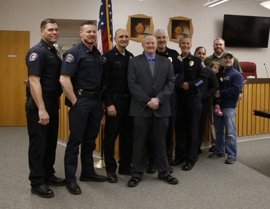 Bloomfield Police Chief David Karst poses for a picture Monda with his former colleagues from Farmington Police Department.